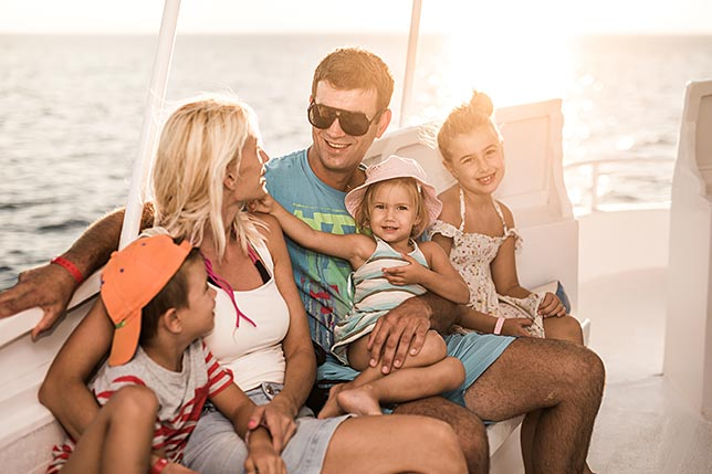 A family on a boat enjoying the day