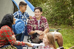 A family enjoying their time at campsite