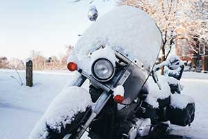 A snow covered bike sitting out in the frigid cold