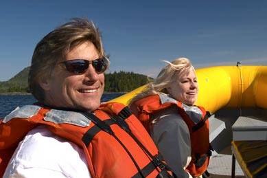 A couple on boat wearing life jackets