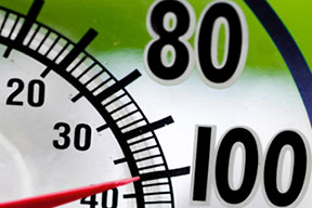 A close-up of a thermometer at 100 degrees